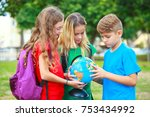 children with a globe are... | Shutterstock . vector #753434992