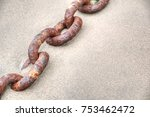 Rusty Old Boat Chain On A Sand...