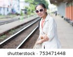 asian woman waiting train on... | Shutterstock . vector #753471448