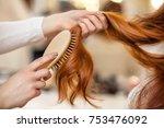 hairdresser combing her long ... | Shutterstock . vector #753476092