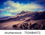 naked mountains and dirt road... | Shutterstock . vector #753486472