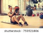 fit sportswoman doing exercise... | Shutterstock . vector #753521806