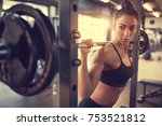 young female doing exercise... | Shutterstock . vector #753521812