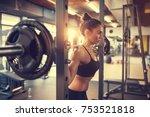 fit beautiful girl doing squats ... | Shutterstock . vector #753521818