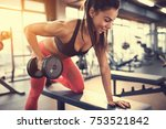 sportswoman in gym exercise... | Shutterstock . vector #753521842