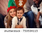 cute sister hugs her little... | Shutterstock . vector #753534115