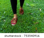 feet with red shoes walking on... | Shutterstock . vector #753540916