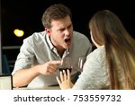 angry couple arguing furiously... | Shutterstock . vector #753559732