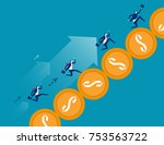 business team running on coin.... | Shutterstock .eps vector #753563722