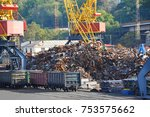 scrap metal  crane and train in ... | Shutterstock . vector #753575662