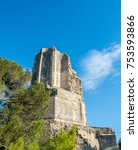 Small photo of Ruined La Tour Magne, the ancient Roman watch tower, part of the Roman city wall from the Augustinian era, in Nimes, France