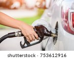 woman pumping gasoline fuel in... | Shutterstock . vector #753612916