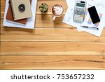 office desk table with stack of ... | Shutterstock . vector #753657232