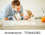 daughter helping father to cook ... | Shutterstock . vector #753663382