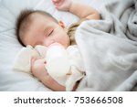sleeeping baby with a milk... | Shutterstock . vector #753666508