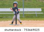 young child playing baseball | Shutterstock . vector #753669025