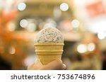 hand holding ice cream on bokeh ... | Shutterstock . vector #753674896