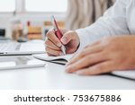 businessman hand working at a... | Shutterstock . vector #753675886