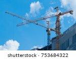 high crane working with blue... | Shutterstock . vector #753684322