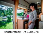 woman cooking in camper ... | Shutterstock . vector #753686278