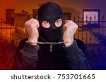 thief in handcuffs   police... | Shutterstock . vector #753701665