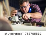 carpenter with an electric... | Shutterstock . vector #753705892