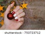 beautiful female hand with red... | Shutterstock . vector #753723712