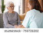 nurse talking to old woman ... | Shutterstock . vector #753726202