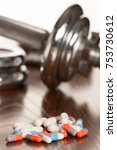 steroid pills with dumbbell... | Shutterstock . vector #753730612