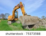 small yellow excavator in a... | Shutterstock . vector #75373588