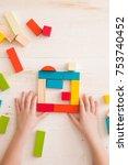 top view on child's hands... | Shutterstock . vector #753740452