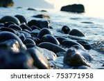 Wet Pebbles On The Sea Shore...