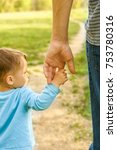 the parent holding the child's... | Shutterstock . vector #753780316