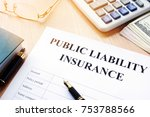 Small photo of Public liability insurance policy on an office desk.