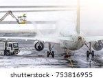 ground crew provides de icing.... | Shutterstock . vector #753816955