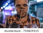 caucasian young male eating... | Shutterstock . vector #753829315