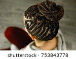 African Braids Are Gathered In...