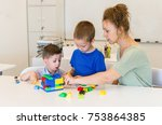 teacher woman play with two... | Shutterstock . vector #753864385