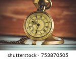 pocket watch and candle | Shutterstock . vector #753870505
