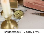 pocket watch and candle | Shutterstock . vector #753871798