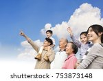 three generations family having ... | Shutterstock . vector #753873148