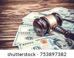 Judge's Gavel With Dollar Bill...