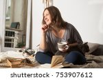 young woman with a cat  lying...   Shutterstock . vector #753907612