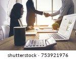 business handshake of two men.... | Shutterstock . vector #753921976