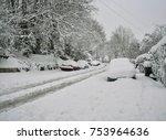 Snowy Suburban Street Scene In...