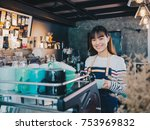 young asian woman barista with... | Shutterstock . vector #753969832