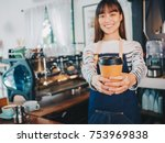 young asian woman barista with... | Shutterstock . vector #753969838