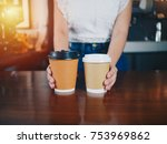 young asian woman barista with... | Shutterstock . vector #753969862