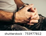 handcuffed soldier in military... | Shutterstock . vector #753977812