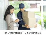 happy young woman receive boxes ... | Shutterstock . vector #753984538